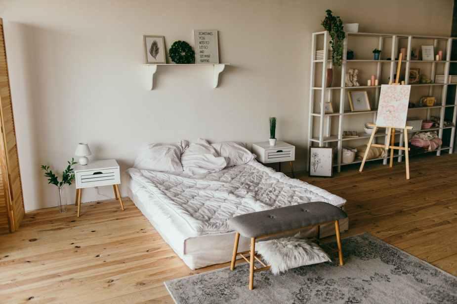 white wooden shelf beside bed