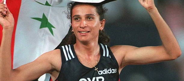 ATLANTA, UNITED STATES: Ghada Shouaa from Syria celebrates at the end of the 800m, the final event of the women's heptathlon in the Olympic athletics competition at the Olympic Stadium in Atlanta, Georgia, 28 July. Shouaa gave Syria its first Olympic title when she won the event with 5,893 pts. (FOR EDITORIAL USE ONLY) AFP IOPP/Georges GOBET (Photo credit should read ROMEO GACAD/AFP via Getty Images)